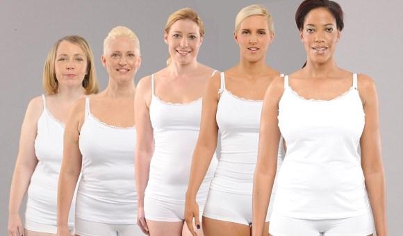 Plusieurs femmes ayant des poids différents sont debout côte à côte